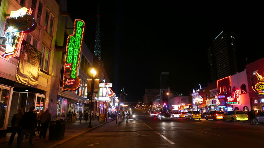NASHVILLE, TENNESSEE - NOV 21, 2016: Street scene on Broadway, the entertainment district area in Nashville, Tennessee. Famous for historic country music venues and Americana landmarks. | Shutterstock HD Video #21932908
