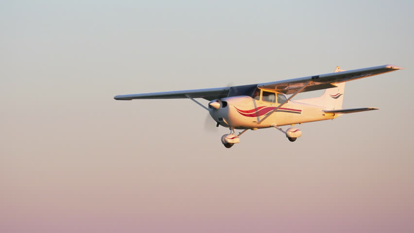 Small propeller driven airplane filmed from an other airplane flying next to it