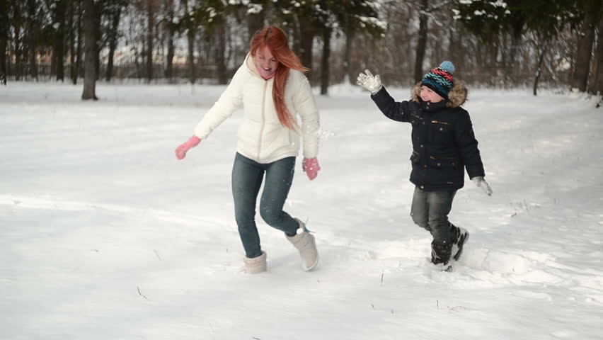 Mother and son having fun in the snow wonderful winter day | Shutterstock HD Video #21954388