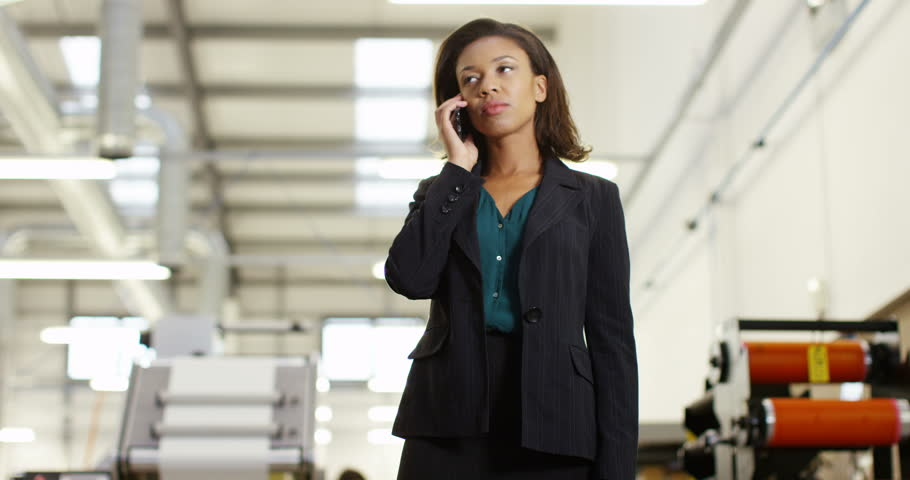 4K Frustrated & annoyed businesswoman in factory dealing with business problems over the phone   Shutterstock HD Video #21974788