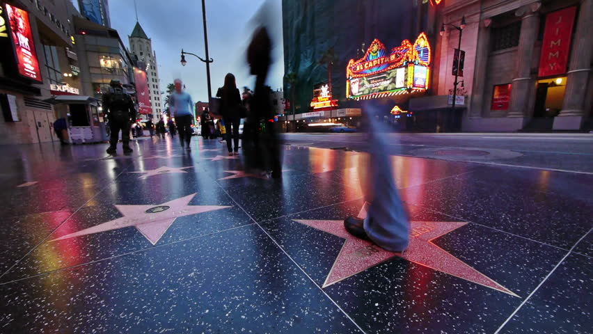 LOS ANGELES - APRIL 23: (Timelapse View) Tourists taking pictures with stars on Hollywood Walk of Fame on April 23, 2012 in Los Angeles, California. Hollywood Walk of Fame is an international tourist attraction in LA.