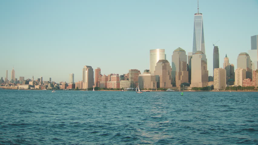 Day Wide across water from New Jersey New York skyline, then pan right see more Manhattan, sailboats, spring summer | Shutterstock HD Video #21988288