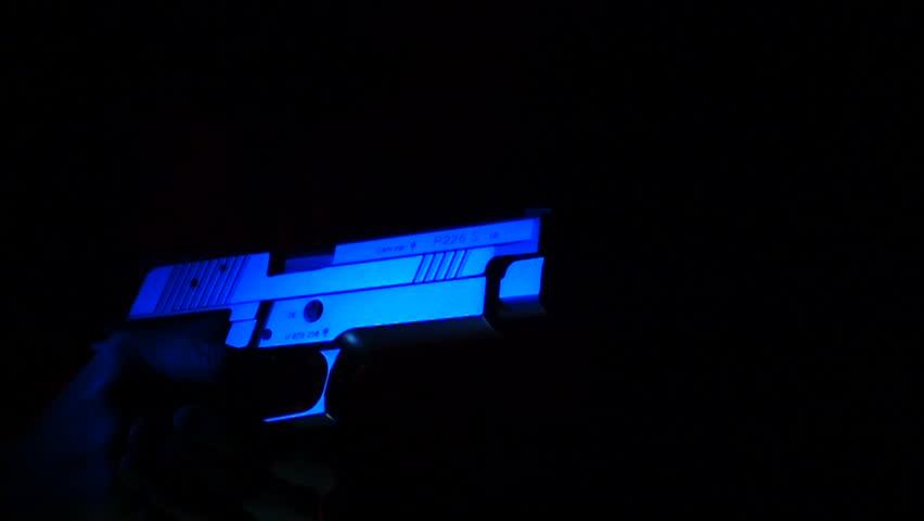 Slow motion SIG Sauer P226 gun close up shoots