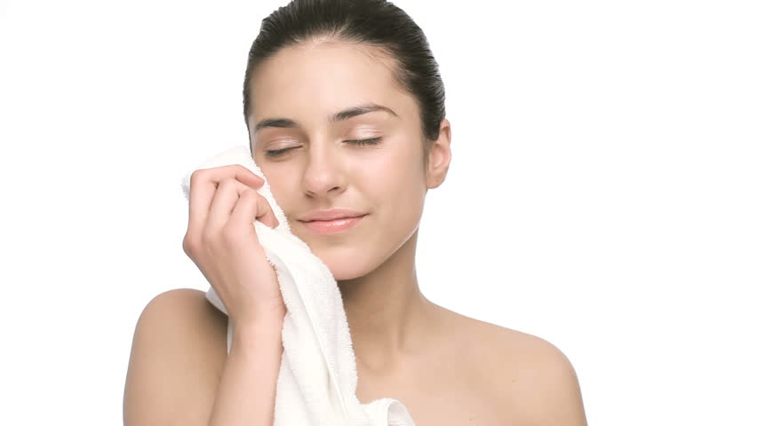 happy female stroking her face with soft clean towel