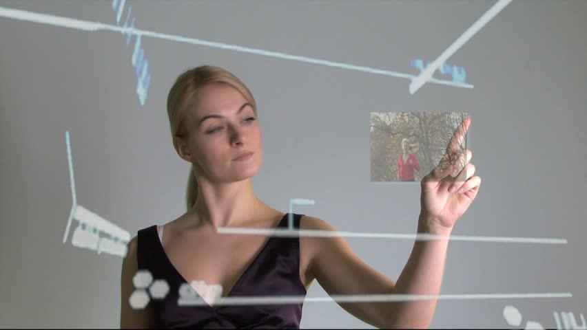 Female touching touch screen wall and scrolling trough life, CGI, static shot, medium shot