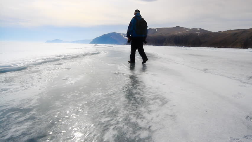 man is going on the ice lake