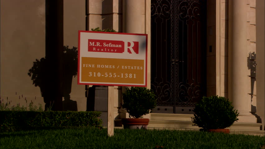 day various zooms sale sign with real phone number well landscaped lawn raked left two story