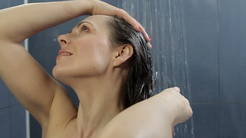 Woman washes her hair