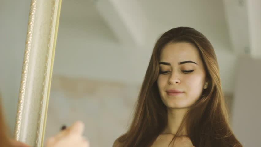 Young adult woman doing makeup by herself   Shutterstock HD Video #22078888