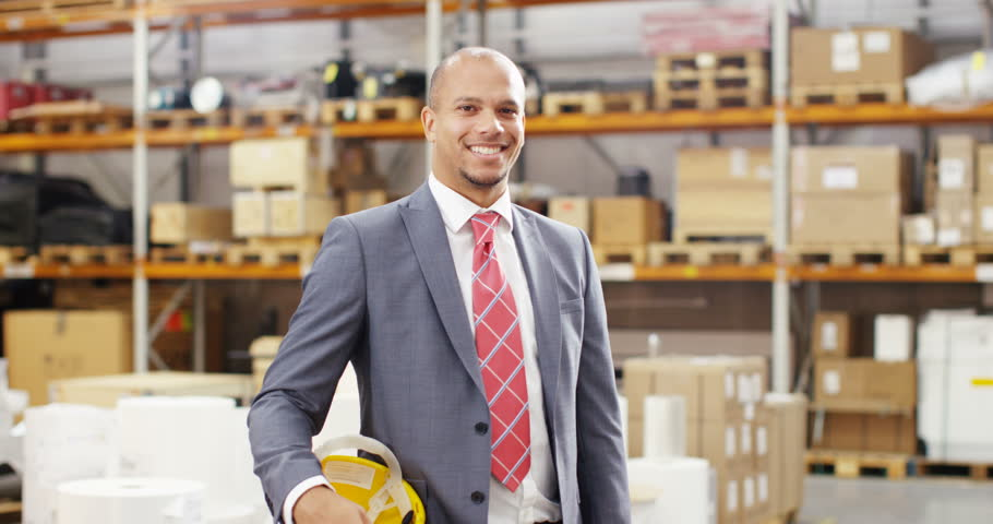 4k, Portrait of a cheerful and friendly male warehouse manager. Slow motion