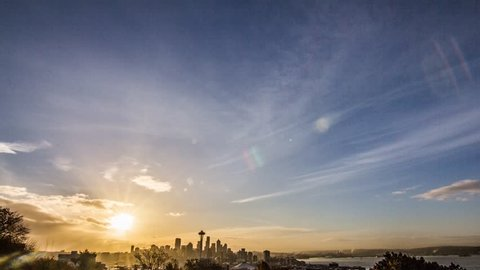 The sun rises and movers over the city of Seattle