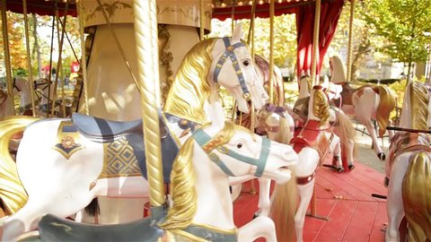 View on a Carousel in the Park Attraction. Vintage Merry-go-round Horses.