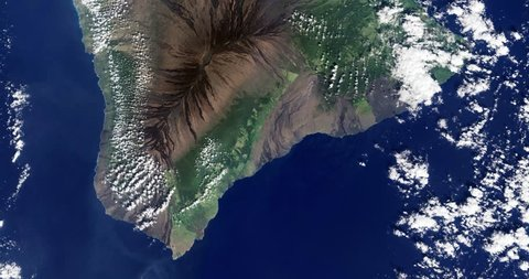 High-altitude overflight aerial of the big island, Hawaii. Clip loops and is reversible. Elements of this image furnished by NASA
