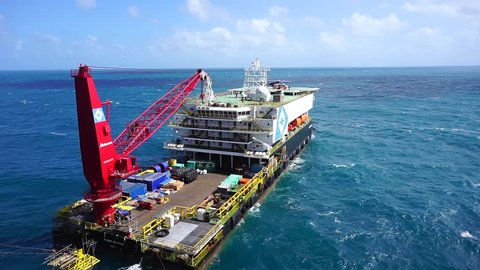 Helicopter landing on barge helideck, Helicopter transfer crews or passenger to work in offshore oil and gas industry, air transportation for support passenger.