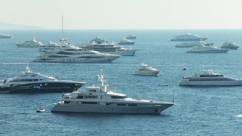 World Fair MYS Monaco Yacht Show, Port Hercules, luxury megayachts, many shuttles, taxi boat, presentations, Journalists, boat traffic, Azur water, aerial view, mountains on background, perspective