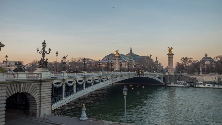side view timelapse of Bridge of Alexandre III over river Seine at summer day, France