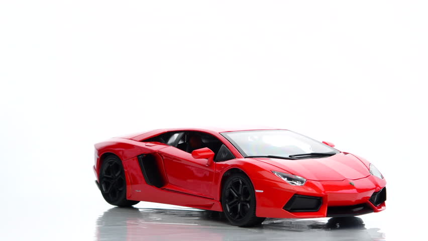 3D Red Concept Sports Car Rotating On White Background In ...