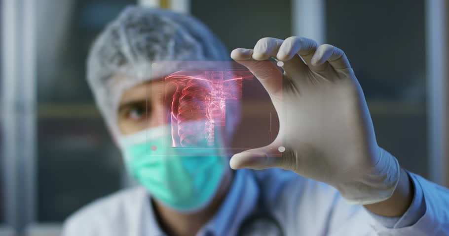 A physician, surgeon, examines a technological digital holographic plate represented the patient's body, the heart lungs, muscles, bones. Concept: Futuristic medicine, the human body, and the future. | Shutterstock HD Video #22212232