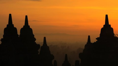 View of Borobudur at sunrise an old religious temple and monument an ancient historic tourism wonder Java Indonesia