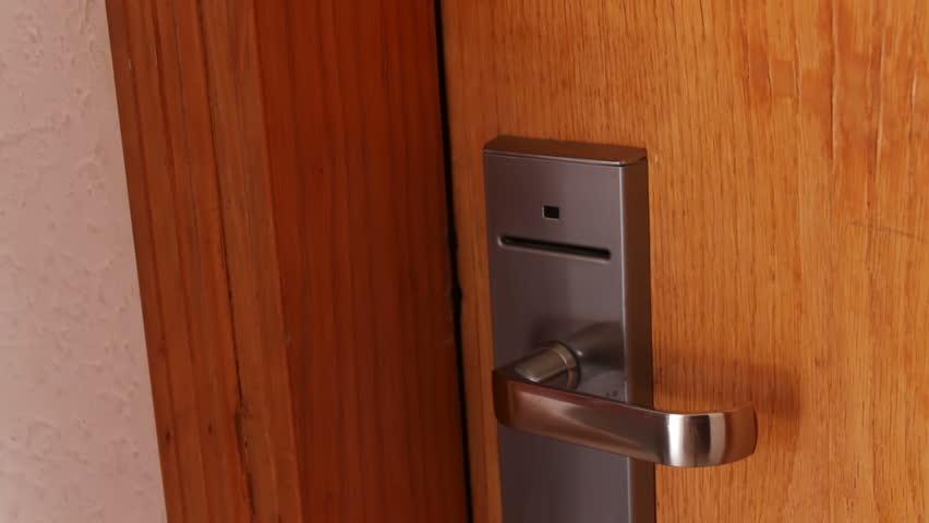 hd0016woman opens the door with the key card & Stock video of wood door unlocked. door is opened.   6156464 ...