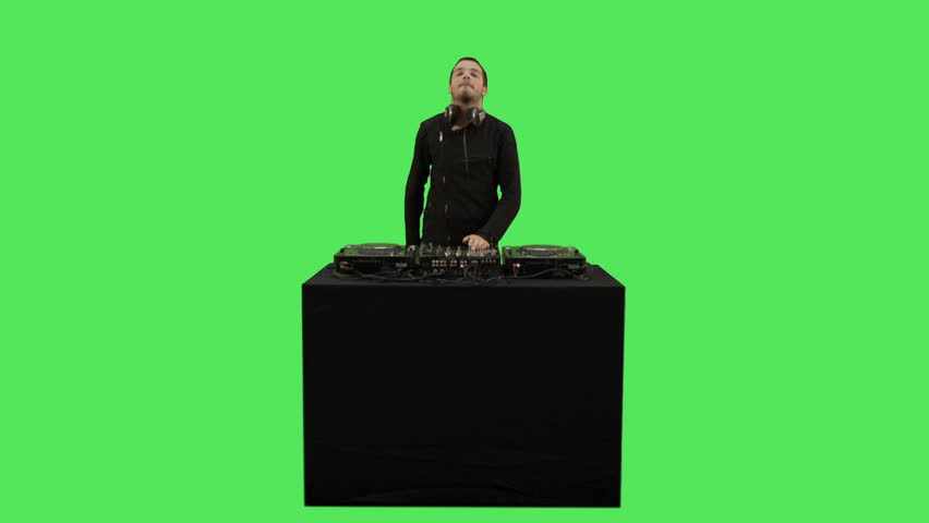 Male DJ playing music on turntable decks