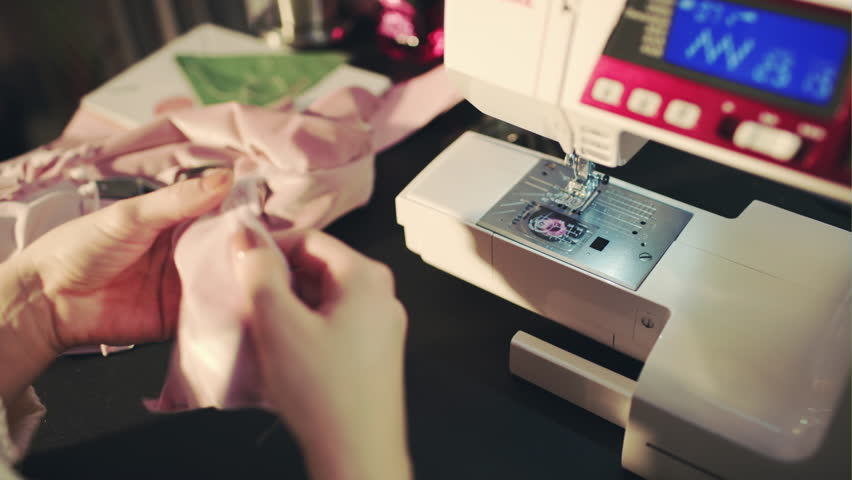 Girl and a sewing machine, creative process in the sewing workshop | Shutterstock HD Video #22326058