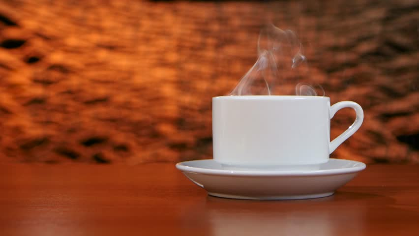 cup of coffee with smoke on table at coffee shop stock footage