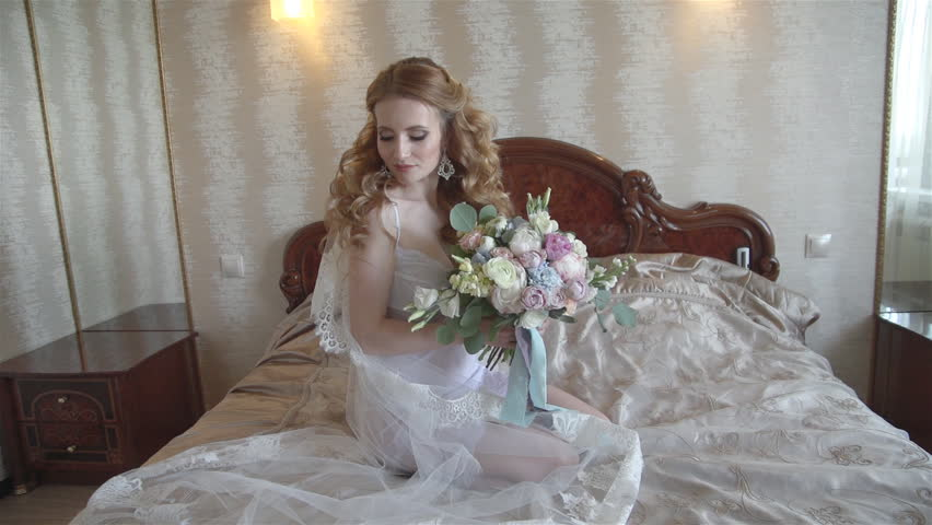 young bride in white lingerie holds Stock Video (HD) Royalty-Free ...