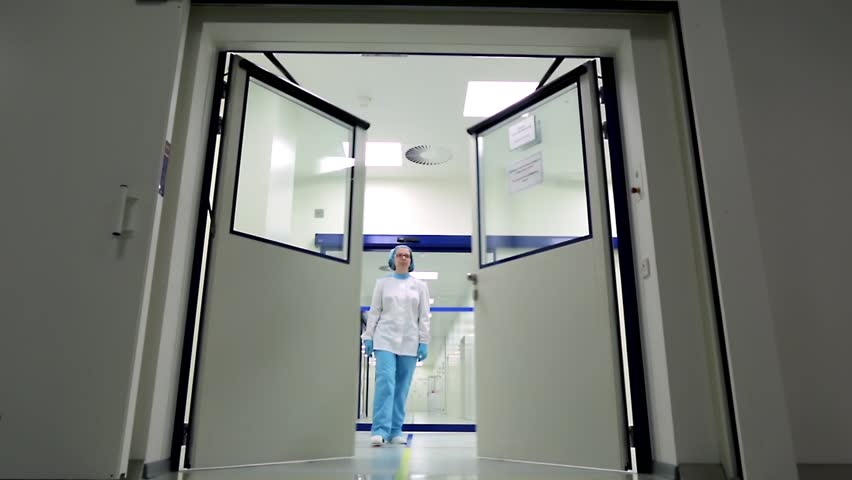 The door opens automatically in front of a doctor or a researcher in a hospital medical laboratory or in a chemical laboratory