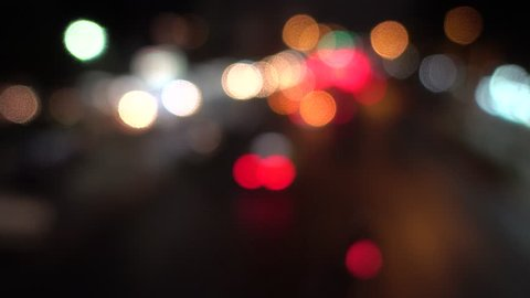 4K Bokeh of car lights. On the street at night Colorful Circles Video Background Loop Glassy circular shapes perform a colorful dance. motion background that is just perfectly suited for DVDs, events