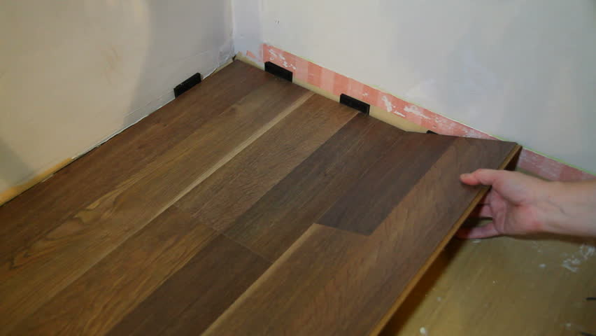 Laying laminate flooring, using pieces of flor that snaps together without glue.