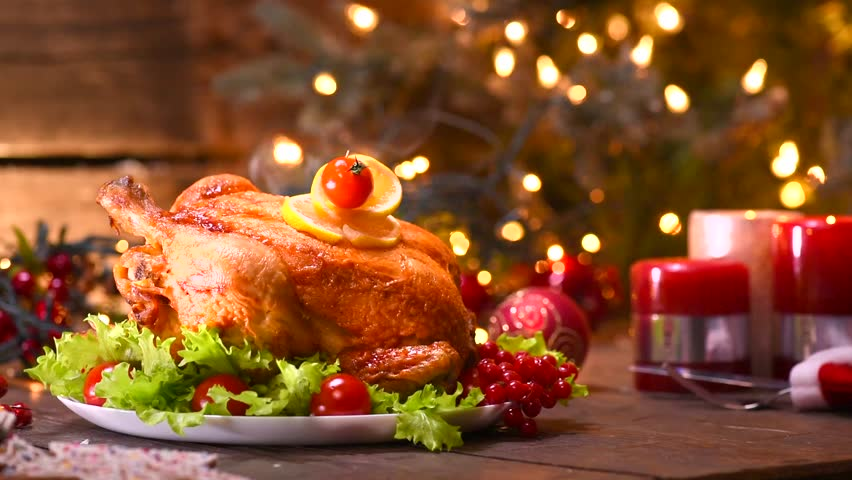 Christmas Roasted Chicken Dinner. Winter Holiday table served decorated with candles. Roast chicken & Christmas Turkey Dinner. Roasted Chicken. Winter Holiday Table ...