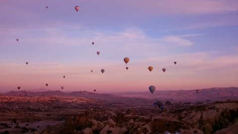 Flying hot air balloons in sunrising time