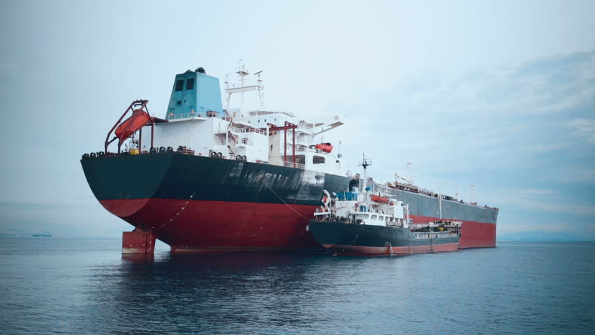 Cargo ship refueling at sea