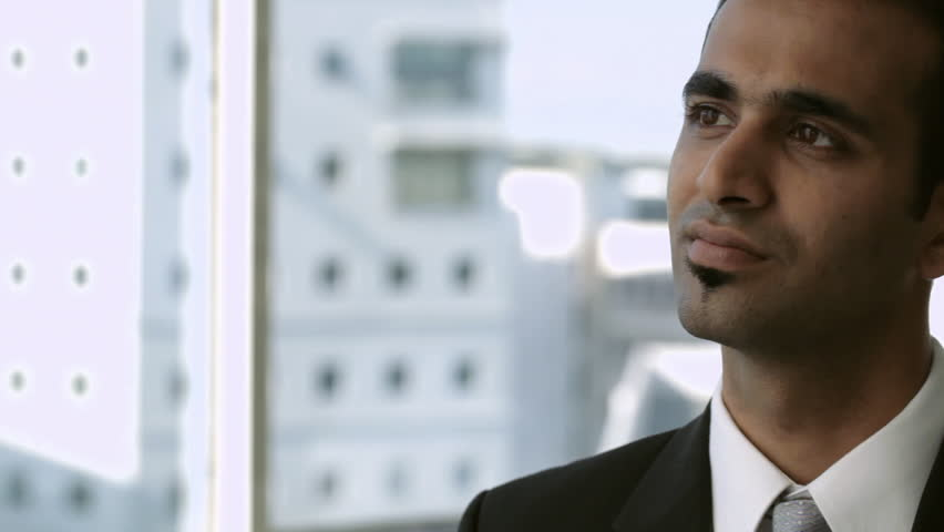 CU PAN Businessman thinking, looking at camera | Shutterstock HD Video #22505278