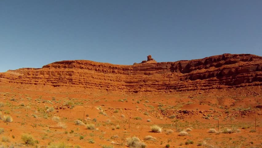 driving through utah's dry wilderness landscape