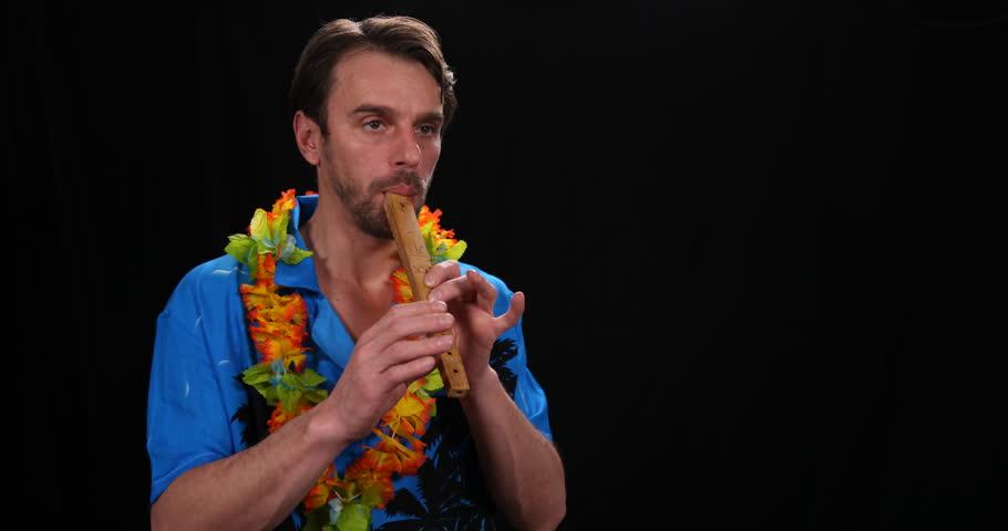 Flutist Man Play Traditional Instrument Recorder Flute World Folk Music Concept. Ultra High Definition, UltraHD, Ultra HD, UHD, 4K, 2160P, 4096x2160