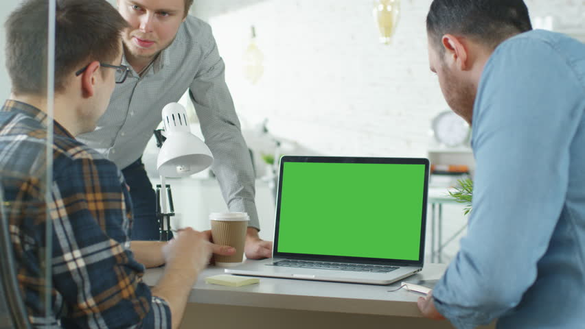 Three Creative Men Discuss Business around Green Screened Laptop. They're in Bright Modern Office.Shot on RED EPIC (uhd). | Shutterstock HD Video #22521145