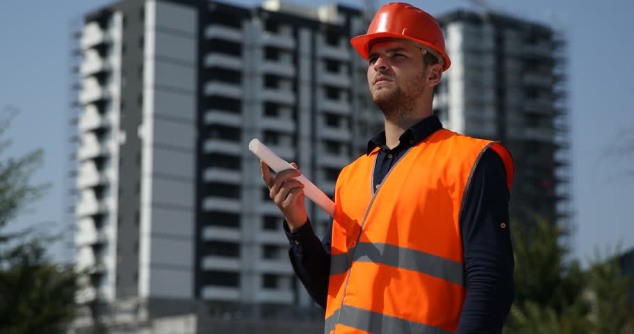 Worker man portrait holding blueprint looking camera under architect expert with scheme plan diagram projection look out unfinished project ultra high definition malvernweather Images