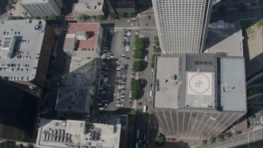 aerial pass over Los Angeles downtown urban streets over the tops of buildings circa 2009