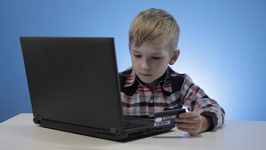 Cute little boy use laptop and credit card | Shutterstock HD Video #22587208