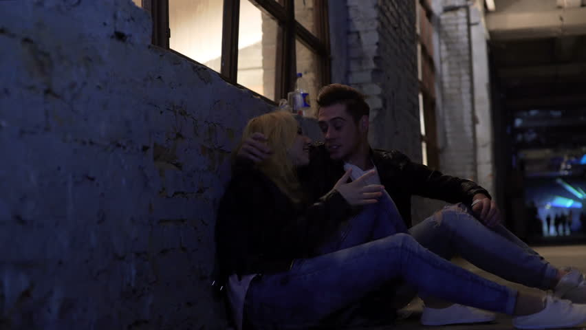Drunk couple sitting on floor near wall and talking, nightlife, hook-up #22632028