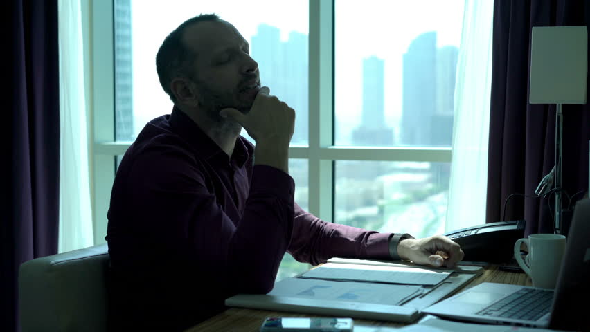Businessman with documents and laptop thinking and having great idea in office   | Shutterstock HD Video #22637548