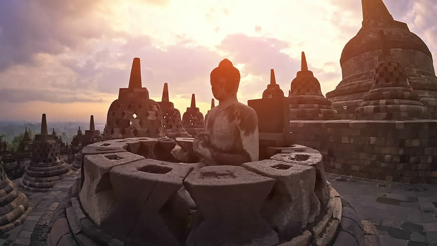 Borobudur temple java Indonesia. Mahayana Buddhist world's largest temple in Magelang. Central dome surrounded by Buddha statues, each seated inside perforated stupa. Buddhism architecture