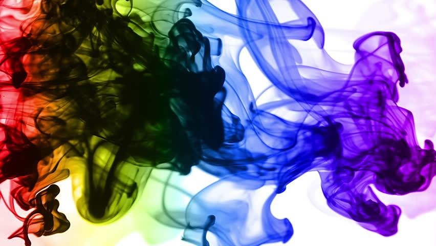 Rainbow Inks in Water (HD). Colorful ink streams traverse across a pale inky water tank shot sideways.
