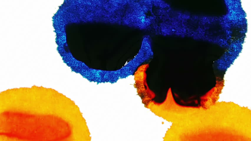 Ink Stains Merging and Expanding (HD). Blue and Orange Ink Expands over time lapse on a white fiber surface.