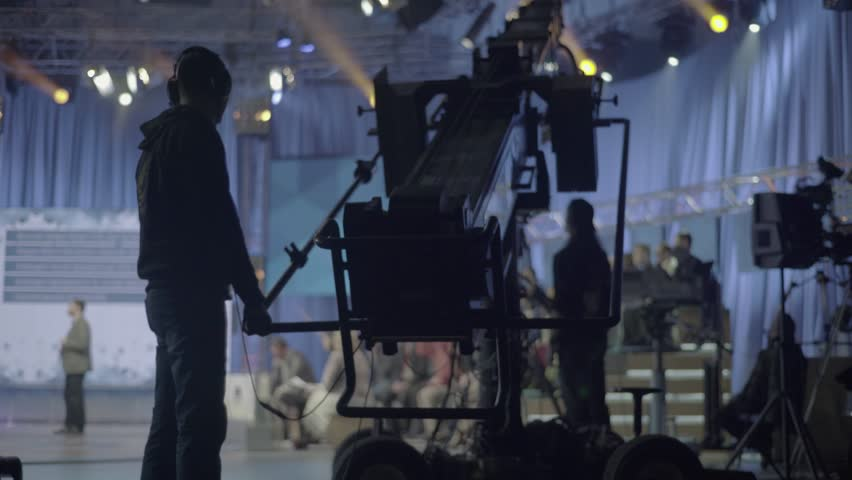 KYIV, UKRAINE – APRIL 13, 2016. Man operating a crane with the camera in TV Studio #22682278