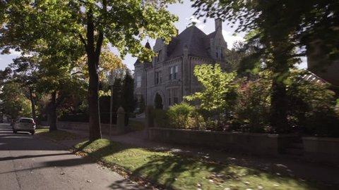 Driving by sunny mansion/ castel in Halifax Nova Scotia