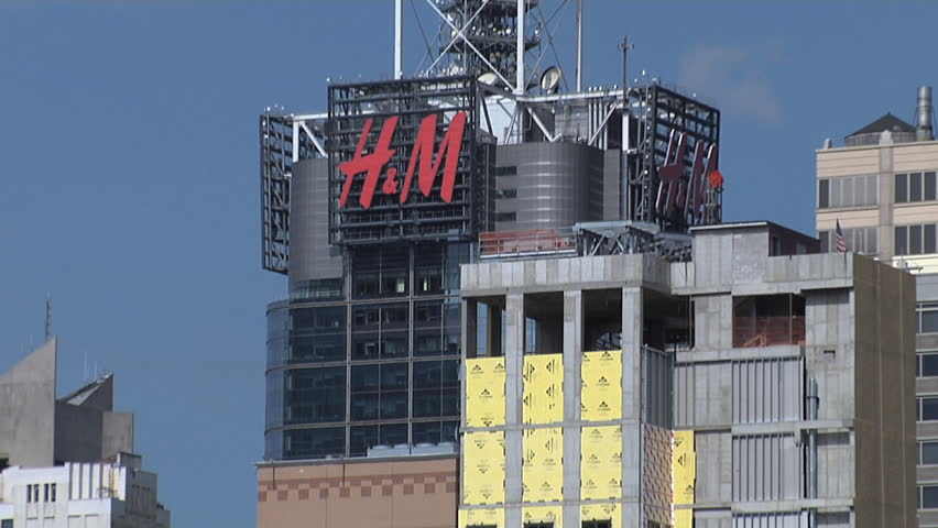 c58b33218c626 New York City - Circa 2016: H&M advertisement sign on a skyscraper building  in Times Square, midtown Manhattan on a clear day.