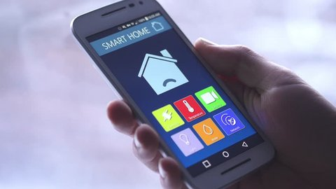 Changing the temperature of the house directly on a smartphone. Winter background.